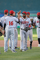 Richmond Flying Squirrels Heliot Ramos (18) high fives Brandon Van Horn (16) after an Eastern League game against the Erie SeaWolves on August 28, 2019 at UPMC Park in Erie, Pennsylvania.  Richmond defeated Erie 6-4 in the first game of a doubleheader.  (Mike Janes/Four Seam Images)