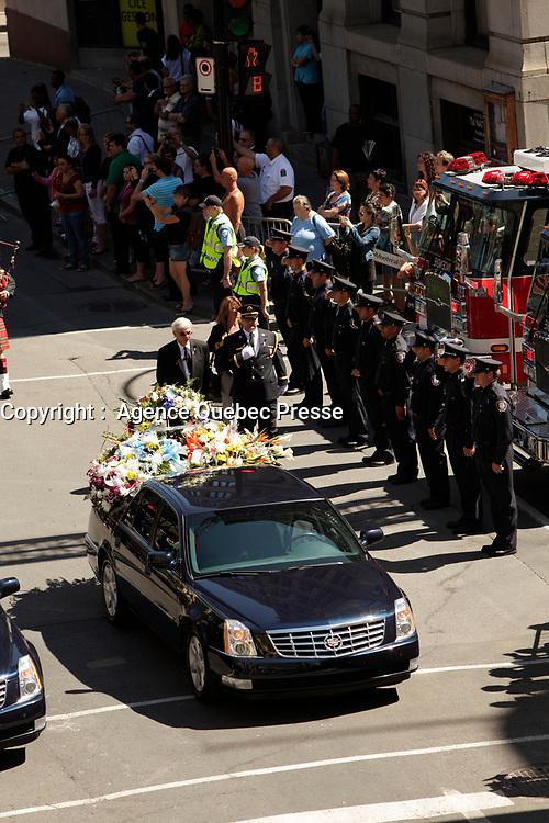 Les funerailles officielles du pompier Thierry Godfrind  vendredi 19 Juillet 2012, à la basilique Notre-Dame à Montreal.<br /> <br /> PHOTOS :  Agence Quebec Presse