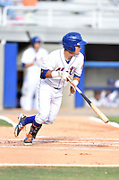 Kingsport Mets shortstop Luis Guillorme #13 follows through on a swing during a game against the Johnson City Cardinals at Hunter Wright Stadium August 24, 2014 in Kingsport, Tennessee. The Mets defeated the Cardinals 9-1. (Tony Farlow/Four Seam Images)