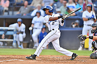 Asheville Tourists Cristopher Navarro (11) swings at a pitch during a game against the Rome Braves at McCormick Field on August 12, 2019 in Asheville, North Carolina. The Tourists defeated the Braves 11-6. (Tony Farlow/Four Seam Images)