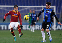 Calcio, ottavi di finale di Coppa Italia: Roma vs Atalanta. Roma, stadio Olimpico, 11 dicembre 2012..AS Roma forward Nico Lopez, of Uruguay, is challenged by Atalanta defender Carlos Javier Matheu, of Argentina, right, during their Italy Cup last-16 tie football match between AS Roma and Atalanta at Rome's Olympic stadium, 11 december 2012. .UPDATE IMAGES PRESS/Isabella Bonotto