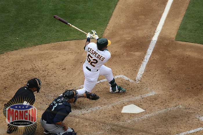 OAKLAND, CA - JUNE 15:  Yoenis Cespedes #52 of the Oakland Athletics bats against the Seattle Mariners during the game at O.co Coliseum on Saturday June 15, 2013 in Oakland, California. Photo by Brad Mangin