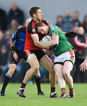 Gary Brennan of Clondegad in action against Keith King of Kilmurry Ibrickane during their senior county final at Cusack park. Photograph by John Kelly.