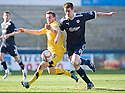 AYR'S KEIGNA PARKER AND RAITH'S DOUGIE HILL CHALLENGE FOR THE BALL
