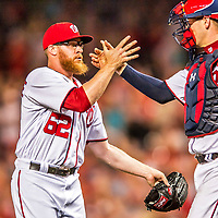 15 August 2017: Washington Nationals pitcher Sean Doolittle celebrates his save and a win over the Los Angeles Angels at Nationals Park in Washington, DC. The Nationals defeated the Angels 3-1 in the first game of their 2-game series. Mandatory Credit: Ed Wolfstein Photo *** RAW (NEF) Image File Available ***