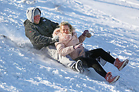 Pictured: Two adults sleigh at Storey Arms in the Brecon Beacons, Wales, UK. Monday 11 December 2017<br /> Re: Freezing temperatures, snow and ice has affected parts of the UK.