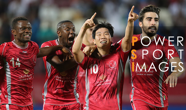 Qatar's Lekhwiya player Nam Tae Hee (2ndR) celebrate with teammates Mohammed Abdullah(L) after scoring a goal against   Iran's Persepolis  during their AFC Champions League soccer match at Abdullah bin Khalifa Stadium  in Doha April 22, 2015.  REUTERS/Fadi Al-Assaad