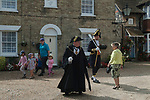 St Bartholomew's Bun Race. The Bartlemas Bun Race at  Sandwich Kent England August 24th 2017. St. Bartholomew's Hospital is one of the oldest established hostels for travellers and pilgrims, dating back possibly to 1190.<br /> Mayor and Mayoress Paul and Sue Graeme.