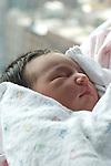 newborn baby girl 1 day old in hospital closeup sleeping asleep vertical