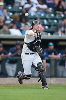 Winston-Salem Dash catcher Zack Collins (8) makes a throw to first base against the Myrtle Beach Pelicans at BB&T Ballpark on May 11, 2017 in Winston-Salem, North Carolina.  The Pelicans defeated the Dash 9-7.  (Brian Westerholt/Four Seam Images)
