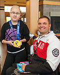 Calgary, AB - June 5 2014 - Mark Ideson shows off his medal during the Celebration of Excellence Heroes Tour visit to Ronald McDonald House in Calgary. (Photo: Matthew Murnaghan/Canadian Paralympic Committee)