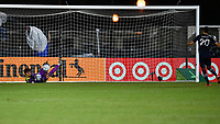 LAKE BUENA VISTA, FL - JULY 26: Thomas Hasal of Vancouver Whitecaps FC saves a shootout attempt by Dániel Sallói of Sporting KC during a game between Vancouver Whitecaps and Sporting Kansas City at ESPN Wide World of Sports on July 26, 2020 in Lake Buena Vista, Florida.