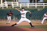 John Swanda (12) of the Inland Empire 66ers pitches against the Lake Elsinore Storm at San Manuel Stadium on July 25, 2021 in San Bernardino, California. (Larry Goren/Four Seam Images)