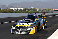 Nov 9, 2013; Pomona, CA, USA; NHRA funny car driver Tony Pedregon during qualifying for the Auto Club Finals at Auto Club Raceway at Pomona. Mandatory Credit: Mark J. Rebilas-