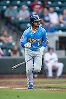 Gleyber Torres (11) of the Myrtle Beach Pelicans tosses his bat as he runs down the first base line during the game against the Winston-Salem Dash at BB&T Ballpark on July 7, 2016 in Winston-Salem, North Carolina.  The Dash defeated the Pelicans 13-9.  (Brian Westerholt/Four Seam Images)