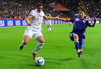 Alex Krieger (l) of team USA and Aya Sameshima of Japan during the FIFA Women's World Cup Final USA against Japan at the FIFA Stadium in Frankfurt, Germany on July 17th, 2011.