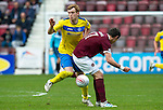 Hearts v St Johnstone....06.05.12   SPL.Liuam Craig is blocked off by Ryan McGowan.Picture by Graeme Hart..Copyright Perthshire Picture Agency.Tel: 01738 623350  Mobile: 07990 594431