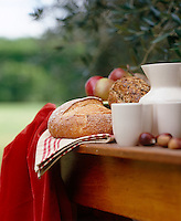 Freshly baked bread laid on an outdoor table