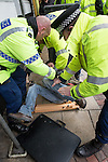 """© Joel Goodman - 07973 332324 . 28/03/2015 . Manchester , UK . A man is detained at the demonstration after a scuffle with police . Approximately 100 neo-Nazis gather in Manchester for """" White Pride Worldwide day """" . Photo credit : Joel Goodman"""