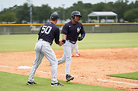 FCL Yankees manager Tyson Blaser congratulates Jose Martinez (36) as he rounds the bases after hitting a home run during a game against the FCL Phillies on July 6, 2021 at the Yankees Minor League Complex in Tampa, Florida.  (Mike Janes/Four Seam Images)