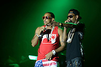 """Largo, MD - July 12, 2014: Grammy award winning Hip Hop entertainer and actor Ludacris (left) performs at the 1st annual International Festival at the Largo Town Center in Largo, MD, July 12, 2014. He is also known for his roles in the """"Fast and Furious"""" movies. (Photo by Don Baxter/Media Images International)"""