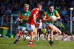 Seán O'Shea, Kerry, in action against Sean Powter, Cork, during the Munster GAA Football Senior Championship Final match between Kerry and Cork at Fitzgerald Stadium in Killarney on Sunday.