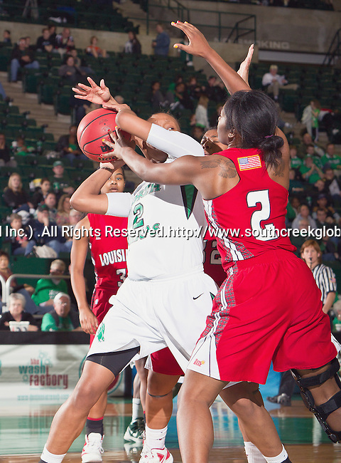 North Texas Mean Green forward Braylah Blakely (2) and Louisiana Lafayette Ragin' Cajuns guard Brooklyn Arceneaux (2) in action during the game between the Louisiana Lafayette Ragin' Cajuns and the University of North Texas Mean Green at the North Texas Coliseum,the Super Pit, in Denton, Texas. UNT defeats Louisiana Lafayette 78 to 40....