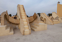 Jaipur, Rajasthan, India.  Jantar Mantar, an 18th-century Site for Astronomical Observations, now a World Heritage Site.  This group of twelve instruments, Rashi Valaya Yantras, are used to calculate the position of the sun among the constellations of the Zodiac.