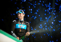 E3 Prijs Harelbeke 2012.Bernie Eisel on the podium with Team Sky branded confetti so it seems...