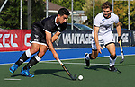 Sam Hiha shadowed by David Brydon. Men's North v South hockey match, St Pauls Collegiate, Hamilton, New Zealand. Saturday 17 April 2021 Photo: Simon Watts/www.bwmedia.co.nz
