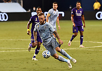 KANSAS CITY, KS - SEPTEMBER 23: #7 Johnny Russell of Sporting Kansas City controls the ball in midfield during a game between Orlando City SC and Sporting Kansas City at Children's Mercy Park on September 23, 2020 in Kansas City, Kansas.