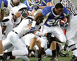 Fossil Ridge High School's Brendan Lamb tries to take down Keller High School's Mandi Onyeabor in the first quarter during their football game on Friday, September 15, 2006.  (photo by Khampha Bouaphanh)