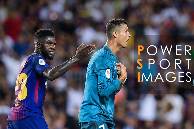 Samuel Umtiti of FC Barcelona (L) and Cristiano Ronaldo of Real Madrid (R) who gestures after gets a red card during the Supercopa de Espana Final 1st Leg match between FC Barcelona and Real Madrid at Camp Nou on August 13, 2017 in Barcelona, Spain. Photo by Marcio Rodrigo Machado / Power Sport Images