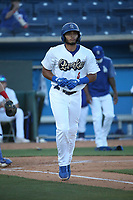 Alex De Jesus (6) of the Rancho Cucamonga Quakes runs to first place during a game against the Stockton Ports at LoanMart Field on May 26, 2021 in Rancho Cucamonga, California. (Larry Goren/Four Seam Images)