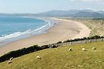 Harlech beach, River Dwyryd estuary in distance and Snowdponia National park. Gwynedd North Wales.