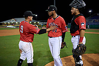 Batavia Muckdogs pitcher Geremy Galindez (34), catcher Andres Sthormes (44), and third baseman Andrew Turner (9) celebrate closing out a NY-Penn League game against the Lowell Spinners on July 11, 2019 at Dwyer Stadium in Batavia, New York.  Batavia defeated Lowell 5-2.  (Mike Janes/Four Seam Images)
