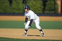 Nate Mondou (10) of the Wake Forest Demon Deacons takes his lead off of first base against the Miami Hurricanes at Wake Forest Baseball Park on March 21, 2015 in Winston-Salem, North Carolina.  The Hurricanes defeated the Demon Deacons 12-7.  (Brian Westerholt/Four Seam Images)