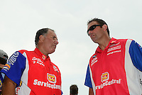 Jul. 1, 2012; Joliet, IL, USA: NHRA funny car driver Johnny Gray (left) with son, pro stock driver Shane Gray during the Route 66 Nationals at Route 66 Raceway. Mandatory Credit: Mark J. Rebilas-