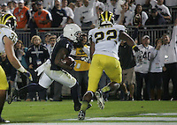 State College, PA - 10/12/2013:  RB Bill Belton scores the winning touchdown in the fourth overtime.  Penn State defeated Michigan by a score of 43-40 in 4 overtimes on Saturday, October 12, 2013, at Beaver Stadium.<br /> <br /> Photos by Joe Rokita / JoeRokita.com