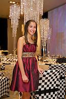 Bat mitzvah girl in an elegant party dress.