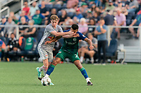 HARTFORD, CT - JULY 10: Cameron Harper #17 of New York Red Bulls II dribbles as Alex Lara #2 of Hartford Athletic defends during a game between New York Red Bulls II and Hartford Athletics at Dillon Stadium on July 10, 2021 in Hartford, Connecticut.