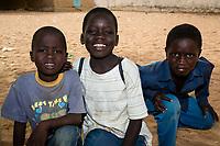 Senegal, Touba.  Three Young Senegalese Boys.