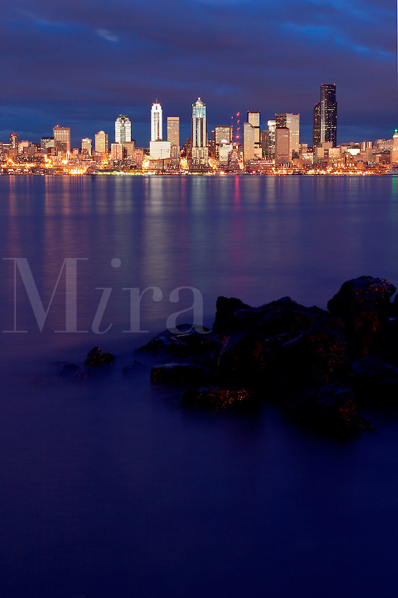 Seattle skyline reflecting in Elliot Bay viewed from West Seattle, Seattle, Washington, US