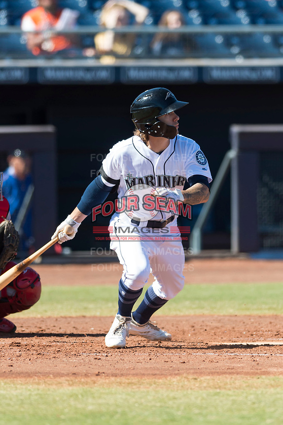 Peoria Javelinas center fielder Ian Miller (9), of the Seattle Mariners organization, follows through on his swing during an Arizona Fall League game against the Scottsdale Scorpions at Peoria Sports Complex on October 18, 2018 in Peoria, Arizona. Scottsdale defeated Peoria 8-0. (Zachary Lucy/Four Seam Images)
