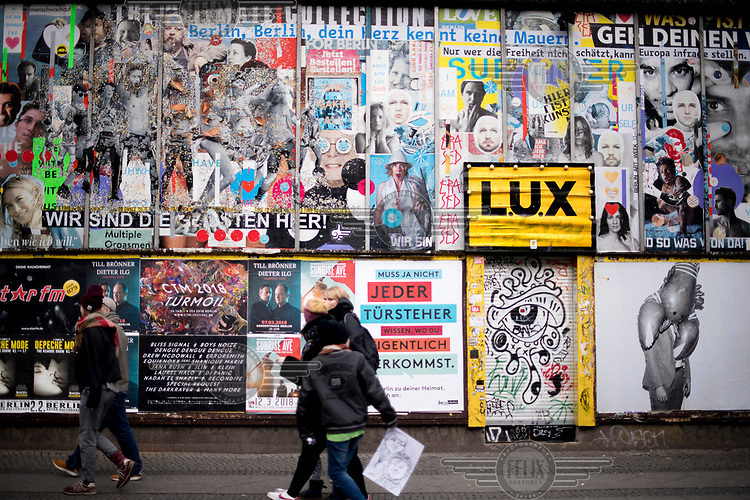 A wall covered in advertisments in Kreuzberg, a district undergoing significant redevelopment and gentrification.