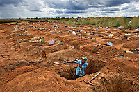 Gravedigger Elijah in a cemetery in a suburb of Harare..
