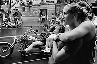 Australia. New South Wales. Sydney. Bikers meeting at King's Cross area. Thee friends ride a black heavy motor tricycle. A loving couple looks at the parade of motorcycles. 7.3.99 © 1999 Didier Ruef