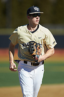Wake Forest Demon Deacons center fielder D.J. Poteet (4) jogs off the field between innings of the game against the Gardner-Webb Runnin' Bulldogs at David F. Couch Ballpark on February 18, 2018 in  Winston-Salem, North Carolina. The Demon Deacons defeated the Runnin' Bulldogs 8-4 in game one of a double-header.  (Brian Westerholt/Four Seam Images)