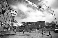 """Nagorny-Karabach, 10.05.2011, Shushi. Kinder spielen in Schuschis Hinterh^fen, W?sche auf Leinen gespannt ist. """"The Twentieth Spring"""" - ein Portrait der s¸dkaukasischen Stadt Schuschi, 20 Jahre nach der Eroberung der Stadt durch armenische K?mpfer 1992 im B¸gerkrieg um die Unabh?ngigkeit Nagorny-Karabachs (1991-1994). Boys playing in a courtyard of Shushi residential houses. Laundry high above on clothes lines is fixed to dry. """"The Twentieth Spring"""" - A portrait of Shushi, a south caucasian town 20 years after its """"Liberation"""" by armenian fighters during the civil war for independence of Nagorny-Karabakh (1991-1994)..Des garçons jouent dans la cour sous le linge en train de sècher. """"Le Vingtieme Anniversaire » - Un portrait de Chouchi, une ville du Caucase du Sud 20 ans après sa «libération» par les combattants arméniens pendant la guerre civile pour l'indépendance du Haut-Karabakh (1991-1994).© Timo Vogt/Est&Ost, NO MODEL RELEASE !!"""
