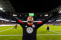 Nick DeLeon (18) of D. C. United celebrates with United fans after the game. D. C. United defeated the New York Red Bulls 1-0 (2-1 in aggregate) during the second leg of the MLS Eastern Conference Semifinals at Red Bull Arena in Harrison, NJ, on November 8, 2012.